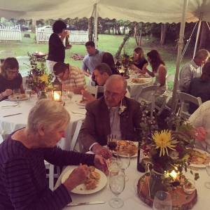 Mom and Dad enjoying a Southern dinner under a lantern lit tent. Beautiful~